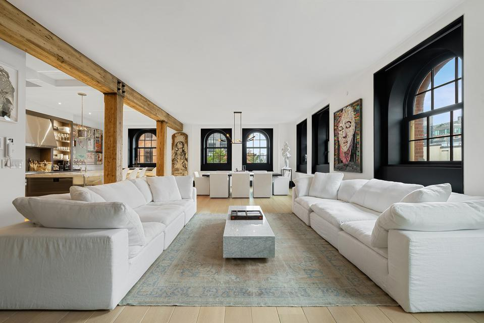 The residence at 443 Greenwich St. features lavish white sofas and stunning views.