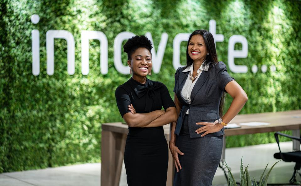Portrait of black business women standing together in eco-friendly office space