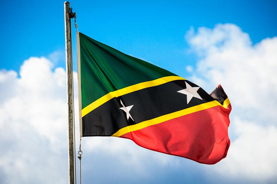 The green, yellow, black, red and white flag of Saint Kitts and Nevis