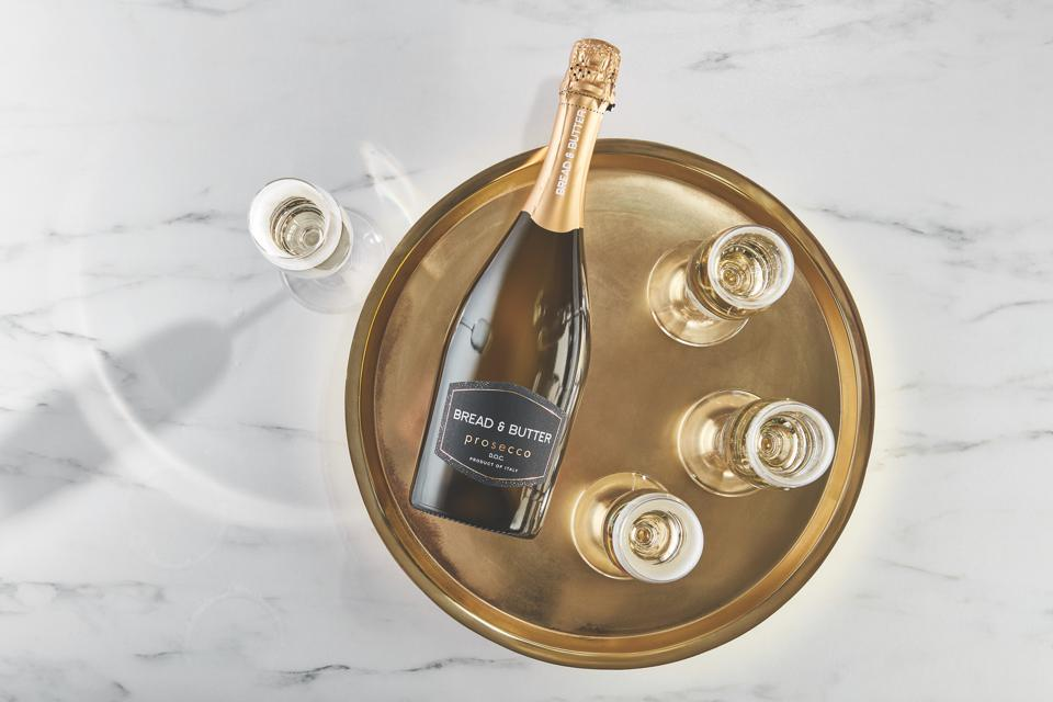 Bread & Butter Prosecco D.O.C. on brass platter with glasses