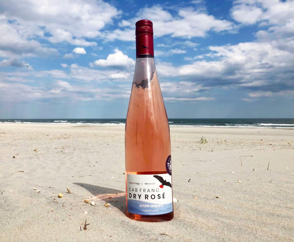 Bottle of Red Tail Ridge x Vin Social Cab Franc Dry Rosé on the beach