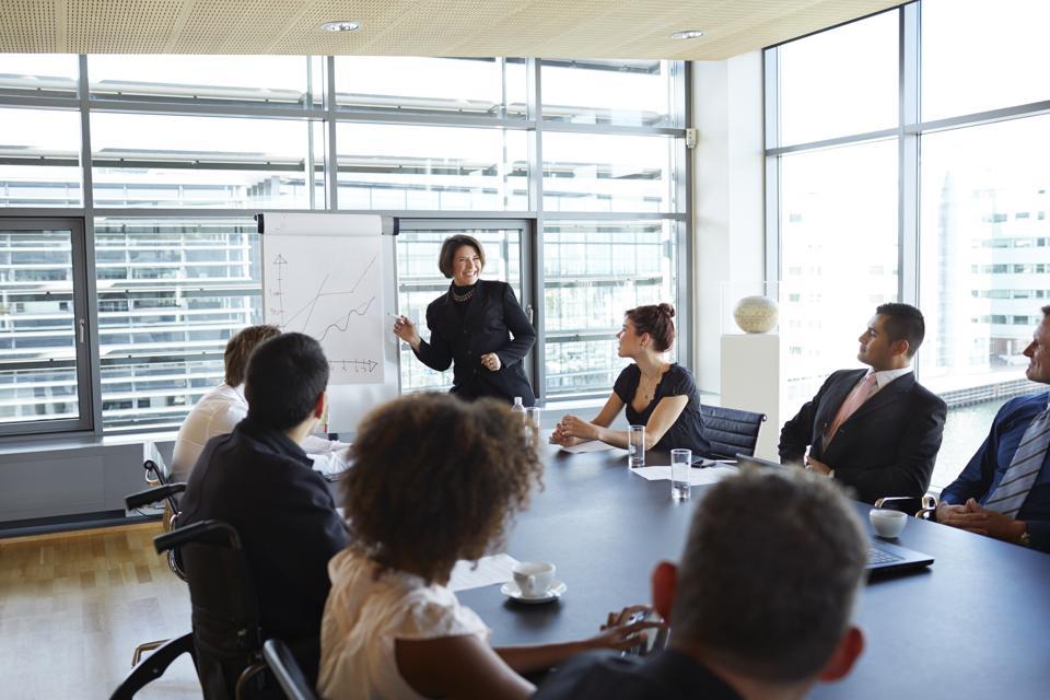 Businesswoman making strategy presentation