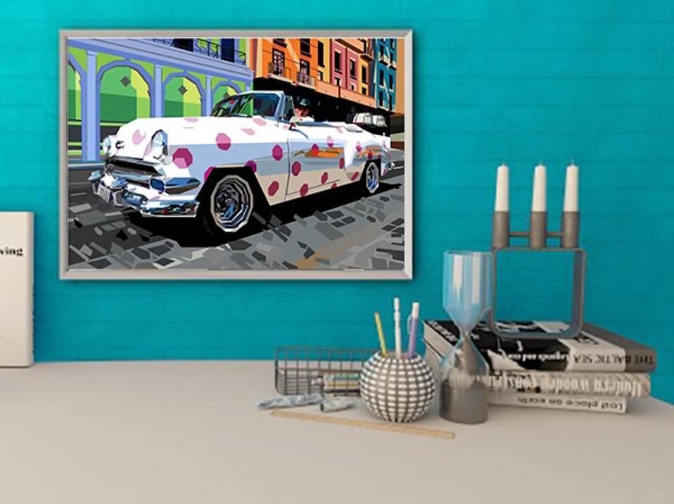 An print of a car over a table against an aqua wall