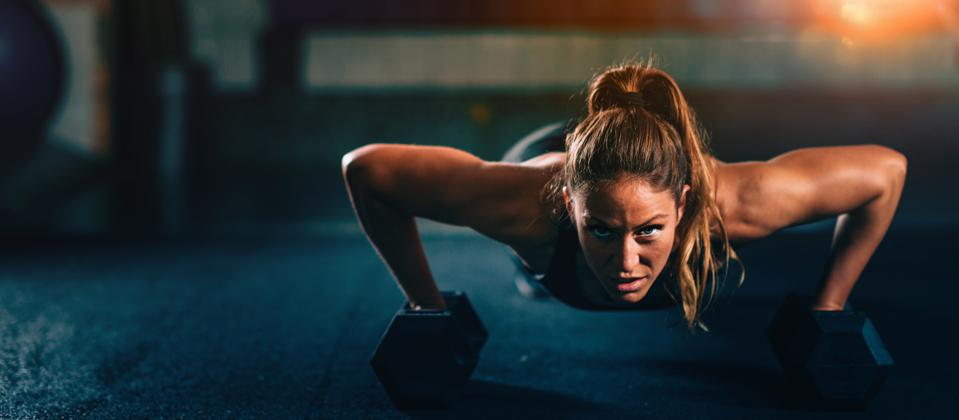 Cross training fitness. Young woman exercising