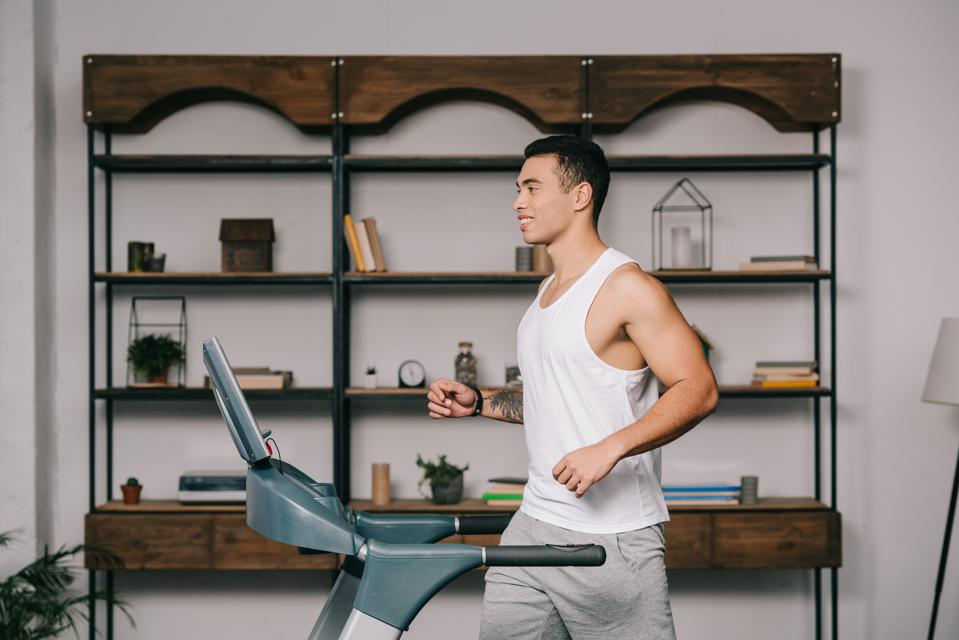 Young man on treadmill at home