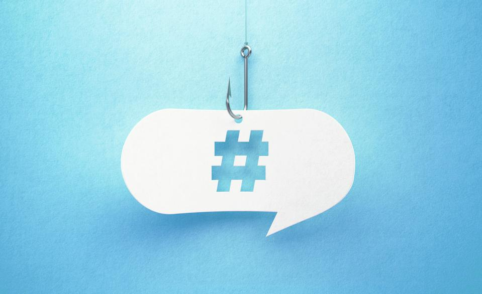 Fishing Hook and Hashtag Symbol Drawn White Chat Bubble On Blue Background