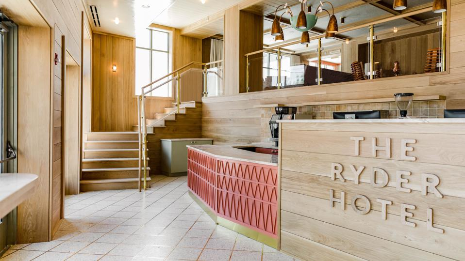 A check in desk with a large sign that says ″The Ryder Hotel″