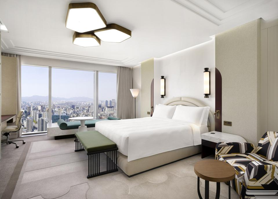 A lushly appointed guest room at the new Josun Palace hotel overlooks the city of Seoul, South Korea.