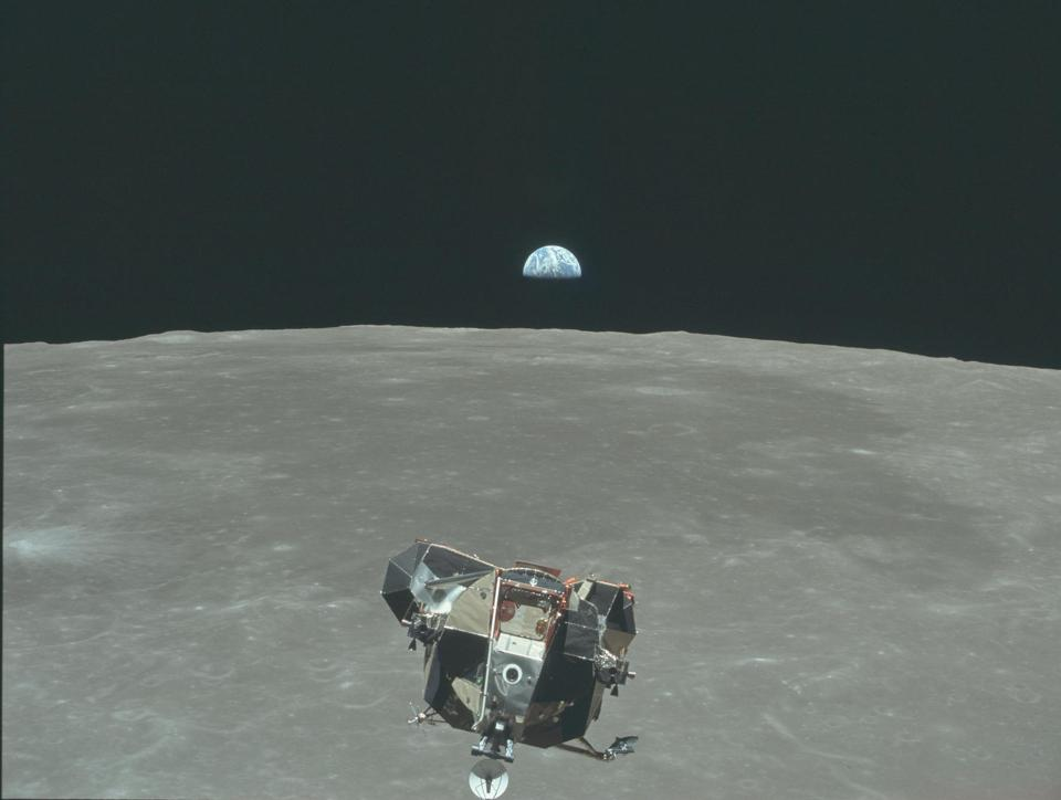 The lunar lander can be seen returning to the orbiting module from Apollo 11.