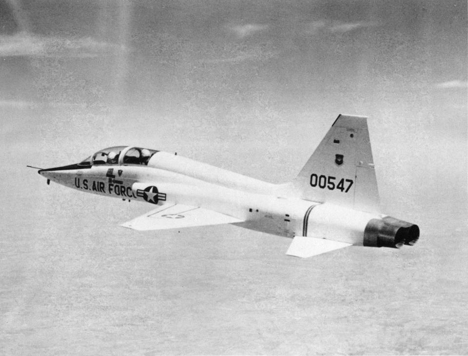 View of a United States Air Force Northrop T-38 Talon jet trainer in flight, 1960s.