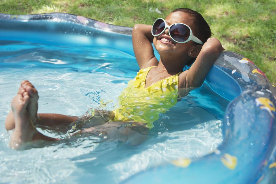 Girl relaxing in kiddie pool