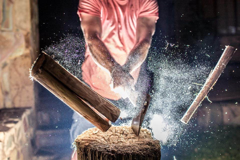 Chopping Wood with an explosion of Dust.