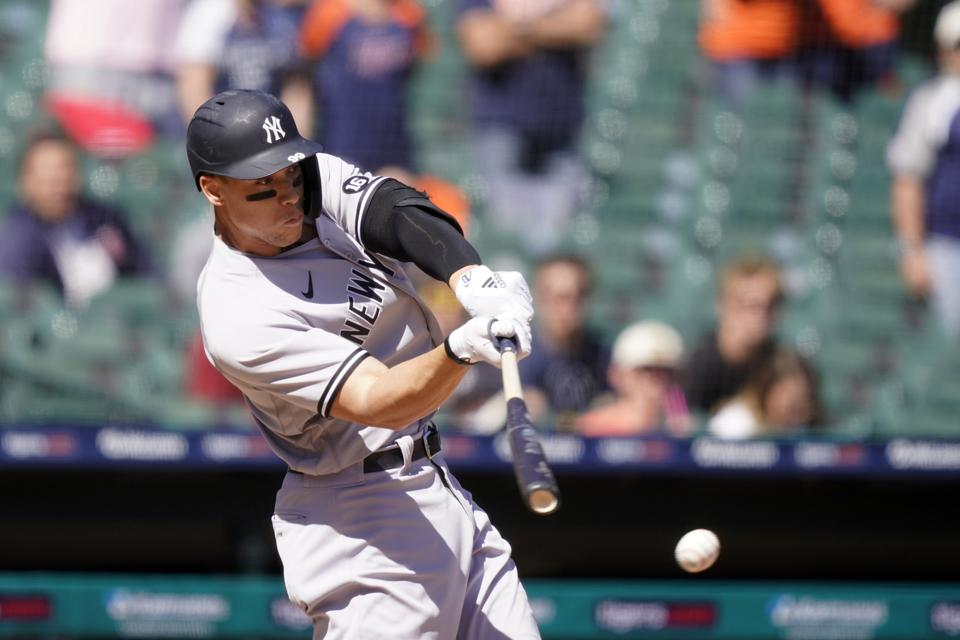 Right-handed hitter Aaron Judge swings at a pitch and misses it.
