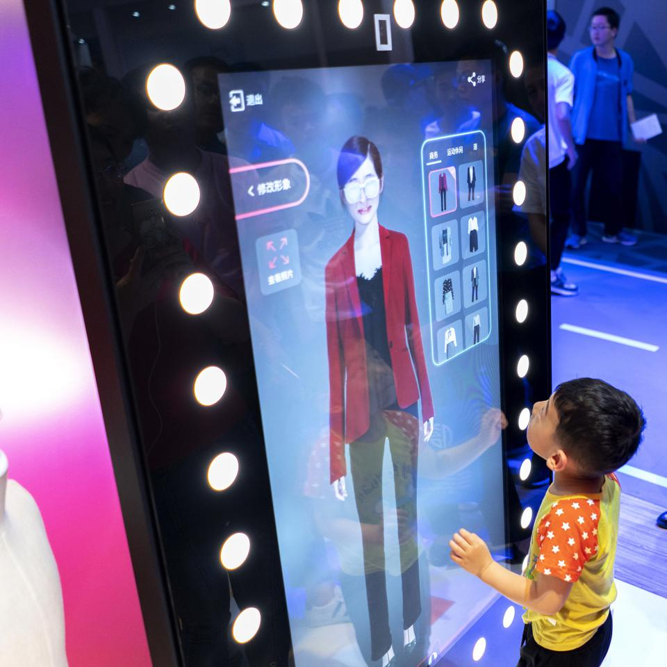 People are experiencing the AI fitting technology while...