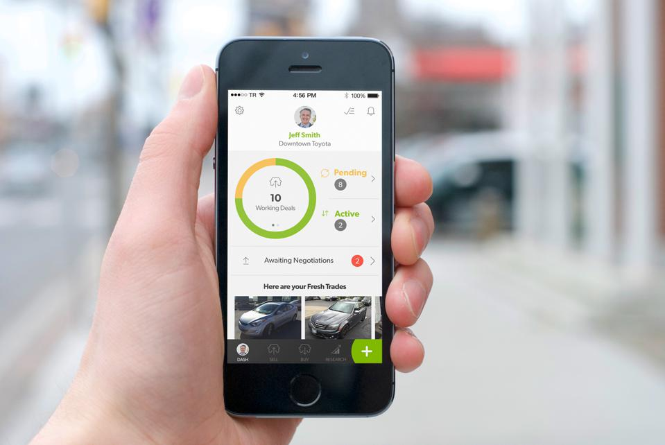 Dealers can use an app like the one pictured here to buy and sell used cars with other dealers.