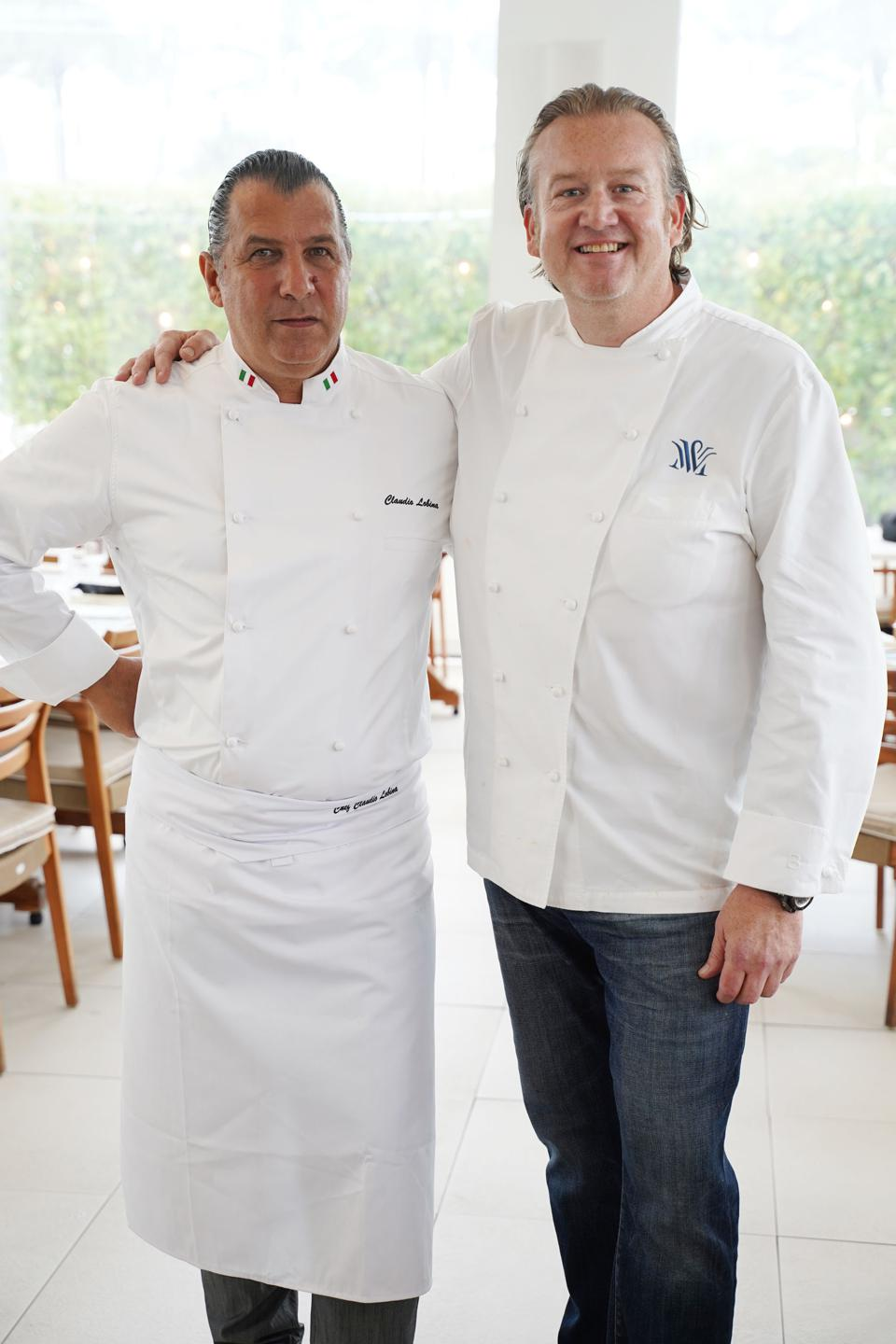 two chefs in white coats at the dinner for SOBEWFF