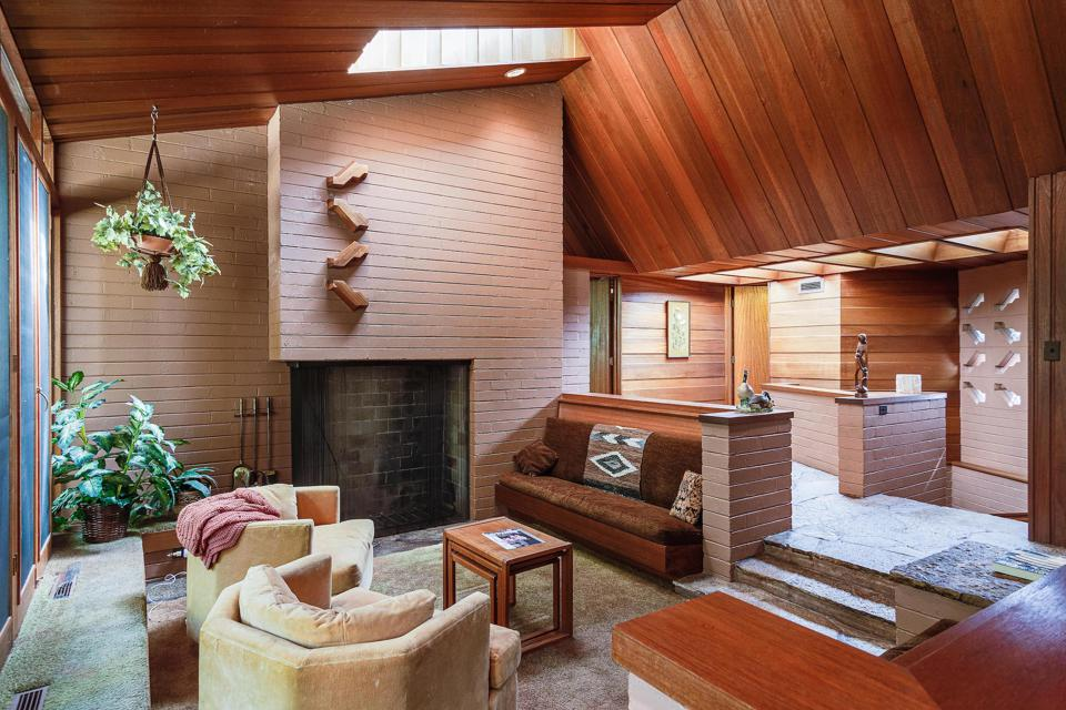 The home features a sunken lounge area, typical of Wright's Usonian home designs.
