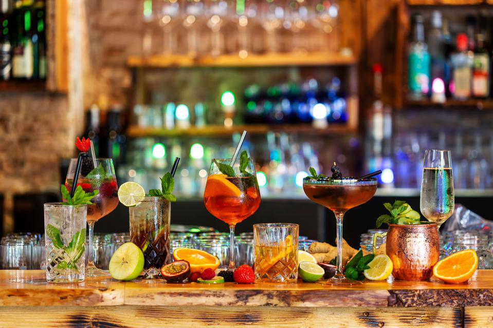 Assortment of alcoholic cocktails on a bar counter