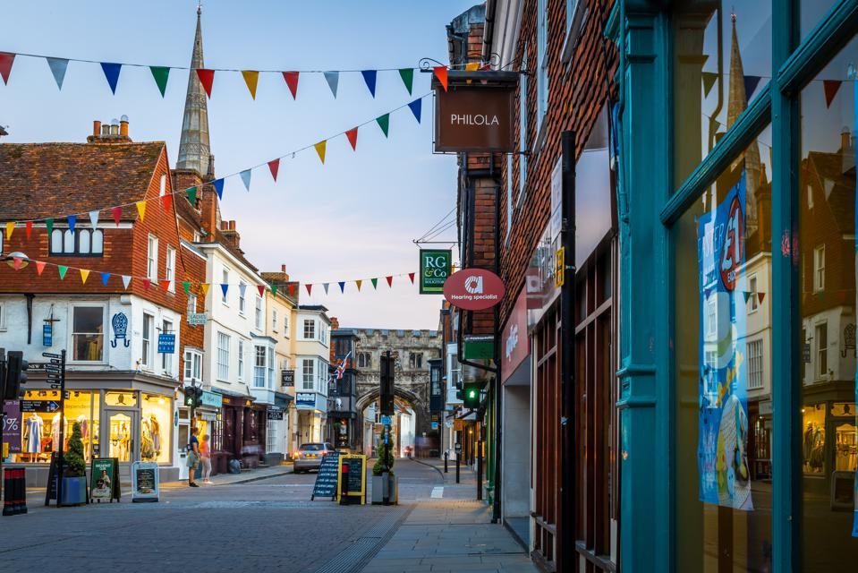 View of Salisbury High Street shops in the evening with bunting outside