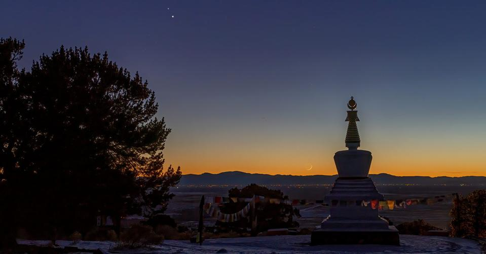 A stupa in the Baca Grande subdivision near Crestone, Colorado, stands to witness the nearing of the Great Conjunction of Jupiter and Saturn in 2020 marked by Earth's moon on the horizon.