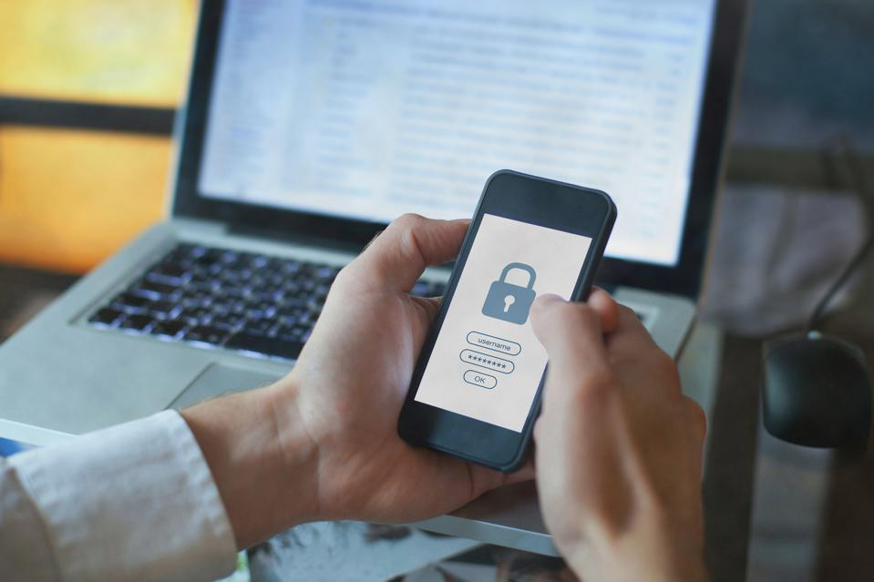 A phone displays a lock screen, implying strong data security.