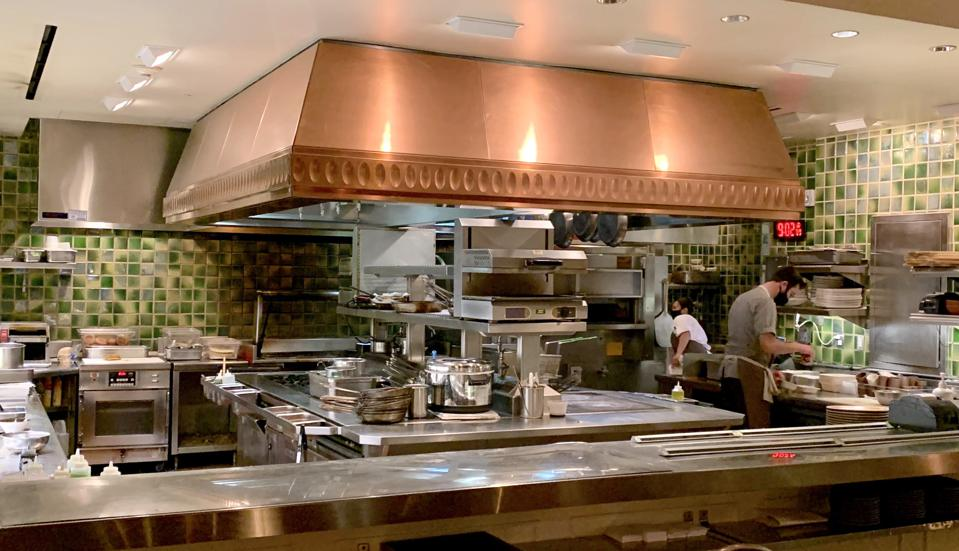 The open kitchen at Madera, sited in the middle of the restaurant at Rosewood Sand Hill in Menlo Park