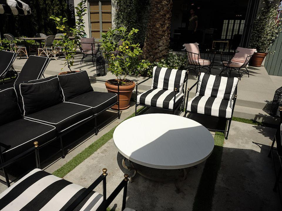 A outdoor space with striped chairs