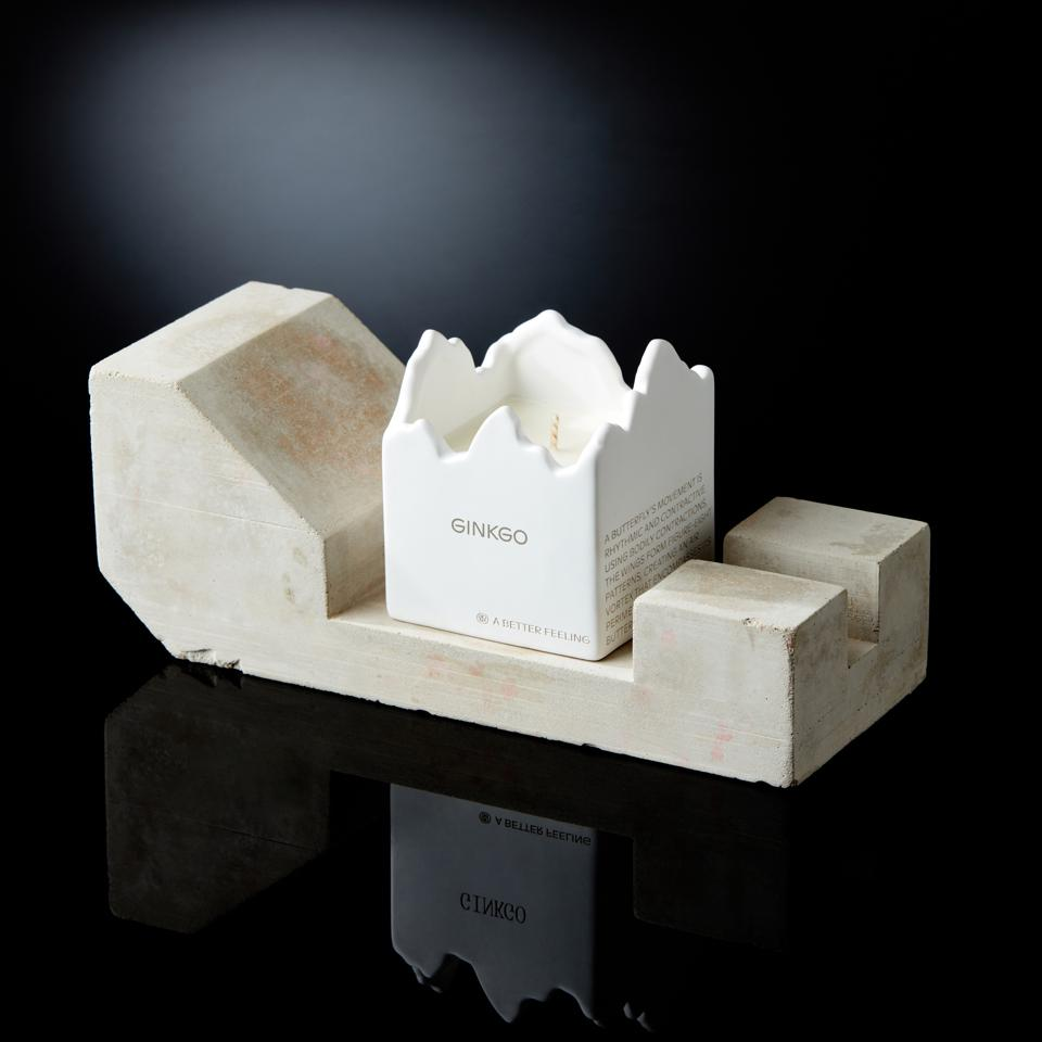 a stylish white candle