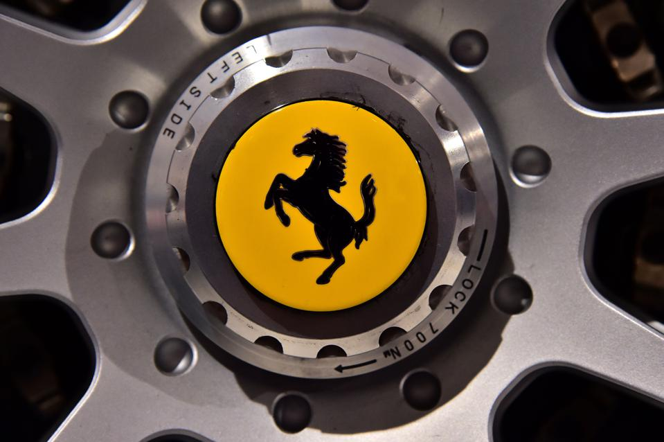 The famous logo of the car manufacturer Ferrari representing a prancing horse photographed at the Ferrari museum in Maranello.