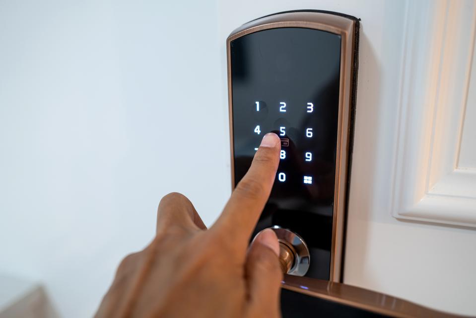 One hand operating the room password lock