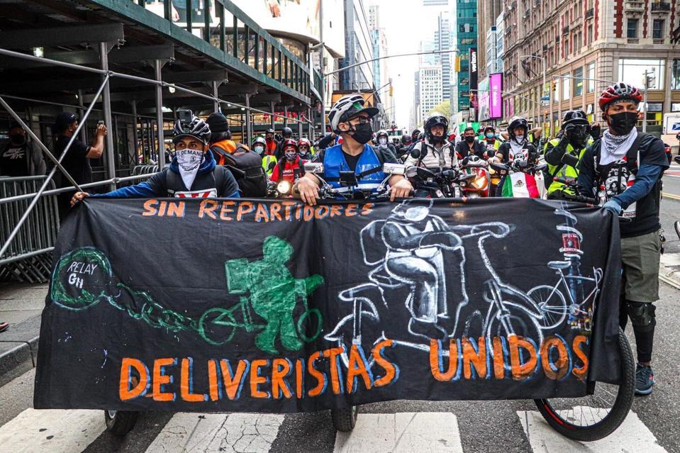 Members of Los Deliveristas Unidos march in New York City.