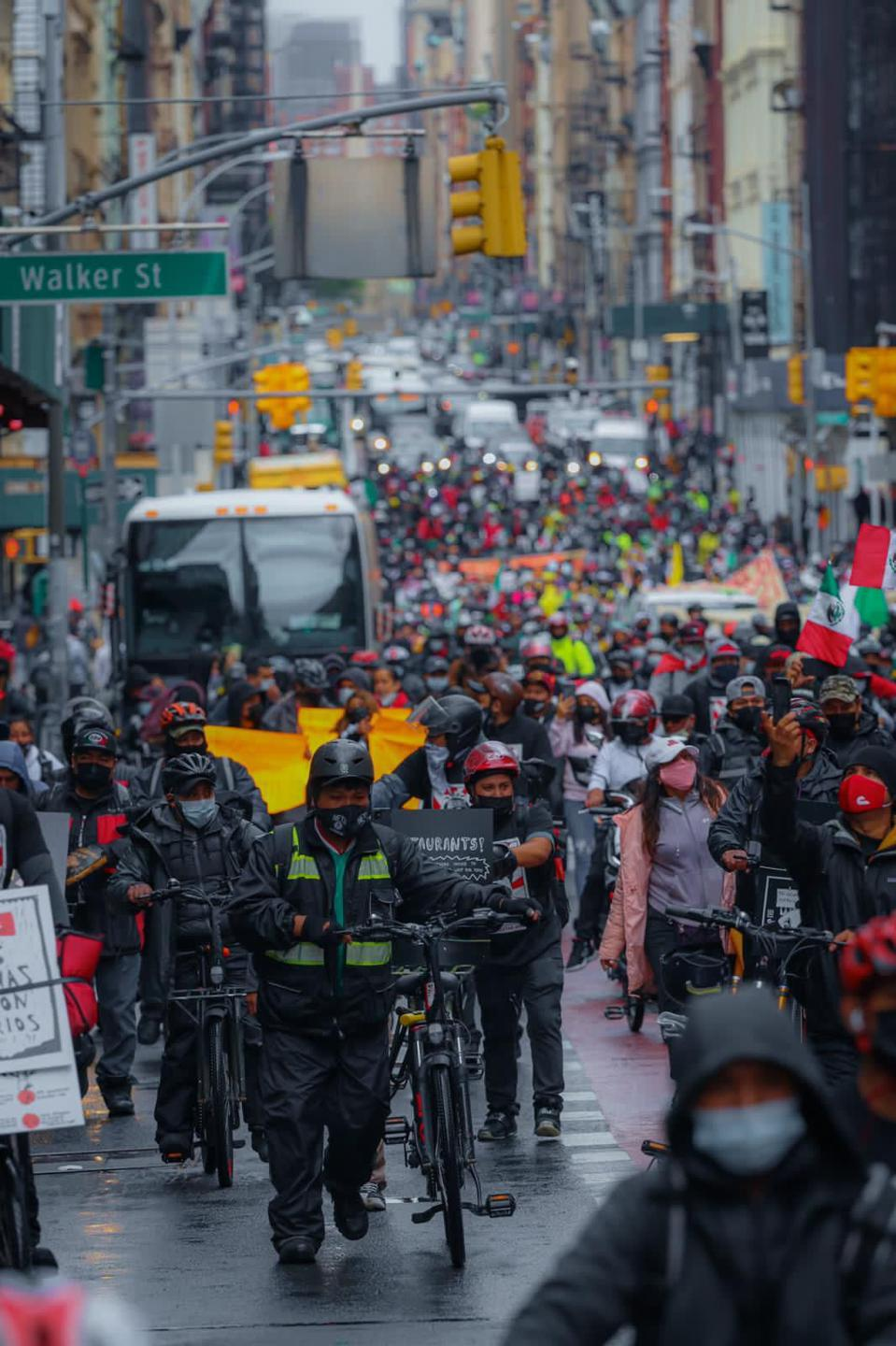Thousands of delivery workers marching across New York City in a heavy downpour this April.