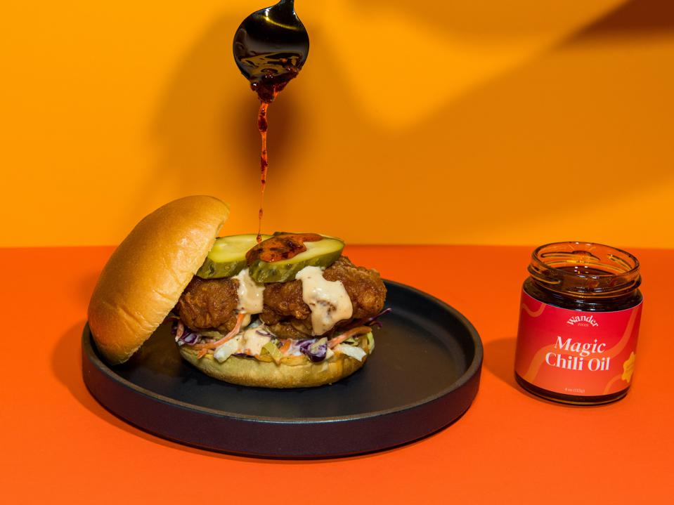 Wander's Magic Chili Oil drizzled on a burger.