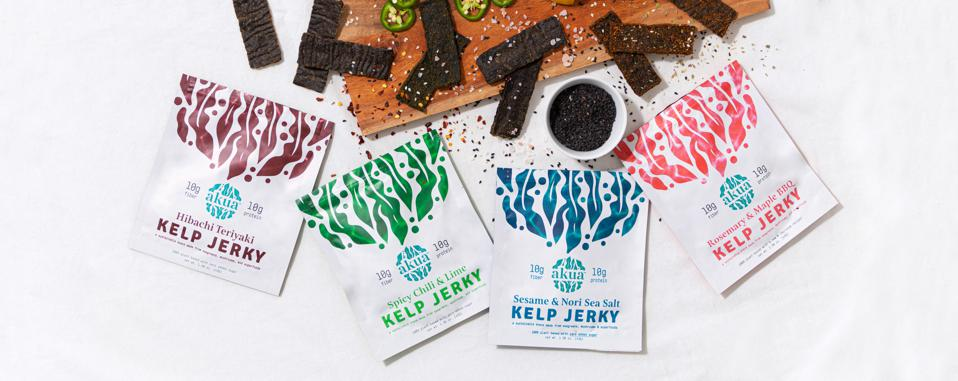 Four packages of AKUA Jerky