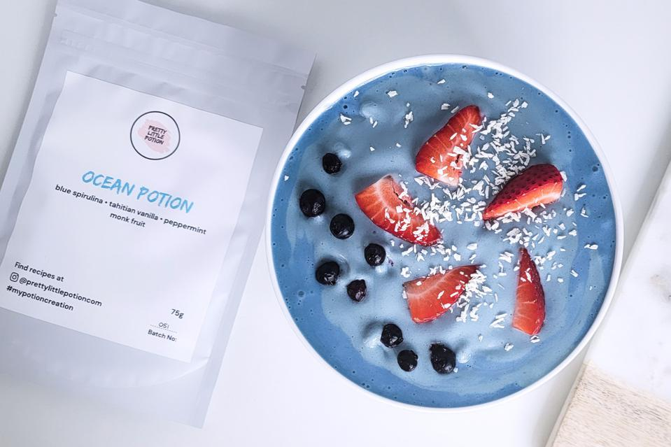 A bowl of yogurt made with Pretty Little Potion's Ocean.
