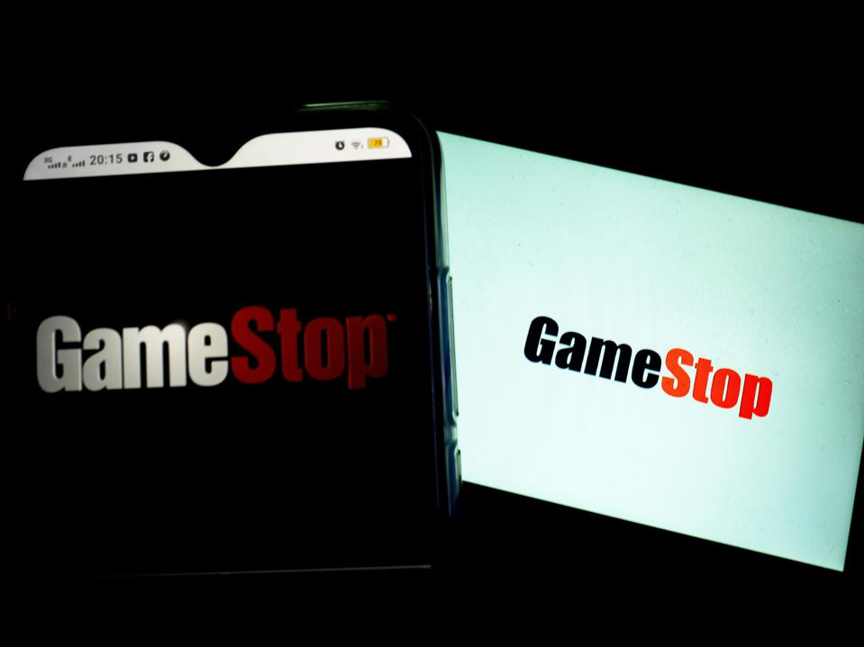 In this photo illustration a GameStop logo seen displayed on...