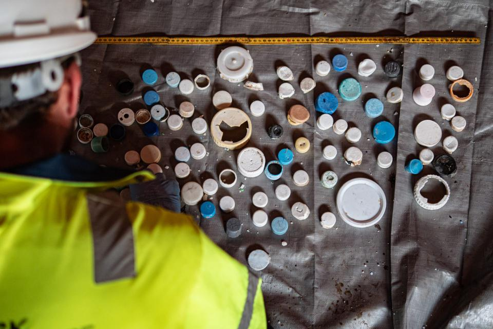 Plastic catch categorized into bottle caps onboard the vessel during the System 001/B campaign