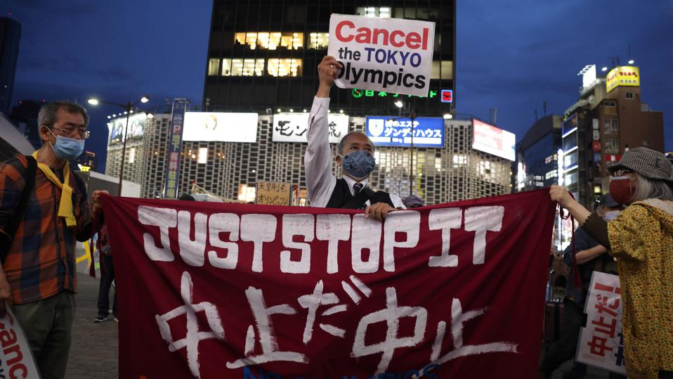 Anti-Tokyo Olympics protesters hold up a banner that reads, ″Just Stop it.″