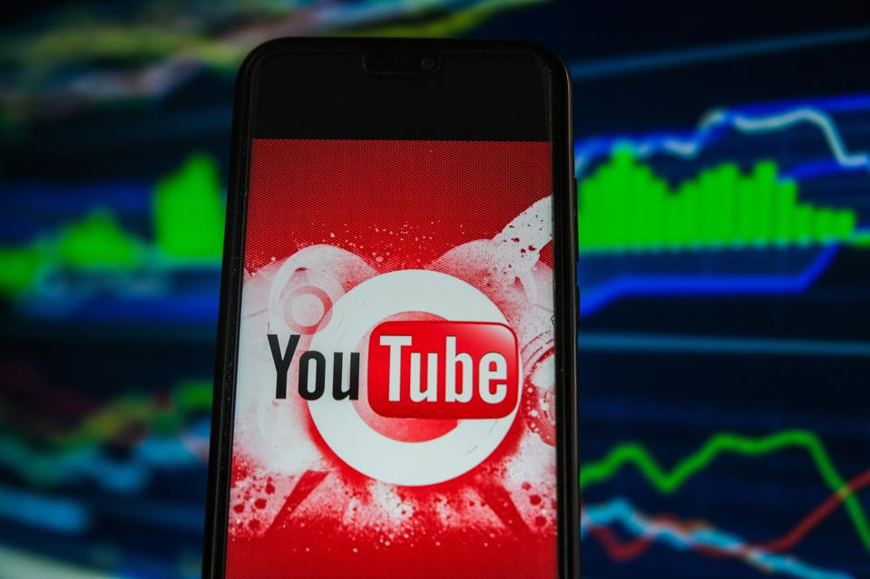 In this photo illustration a Youtube logo is displayed on a...