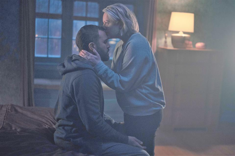 Luke and June embrace in The Handmaid's Tale