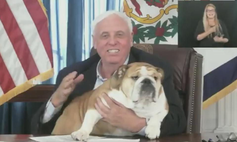Jim Justice with his fat dog.