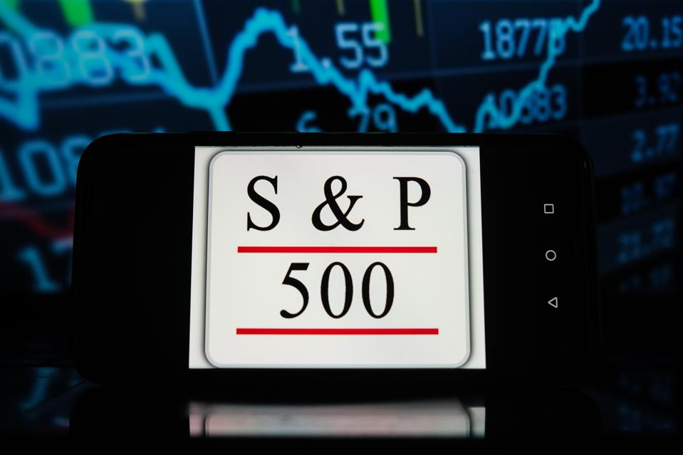 In this photo illustration a S&P 500  logo seen displayed on...