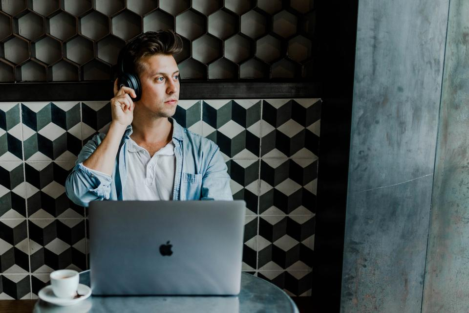Austin Distel in coffee shop with headphones