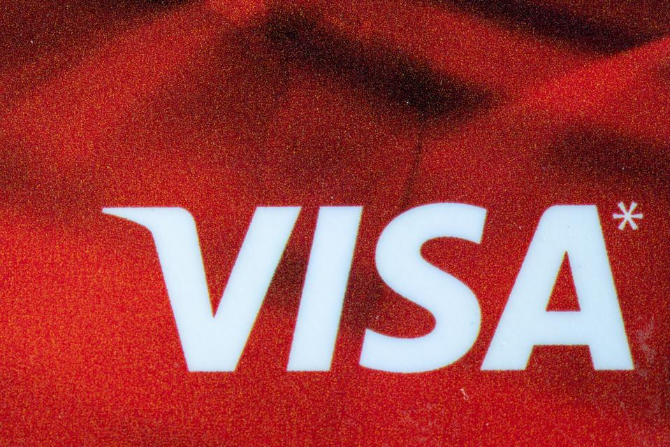 In this photo illustration you see the logo of a VISA credit...