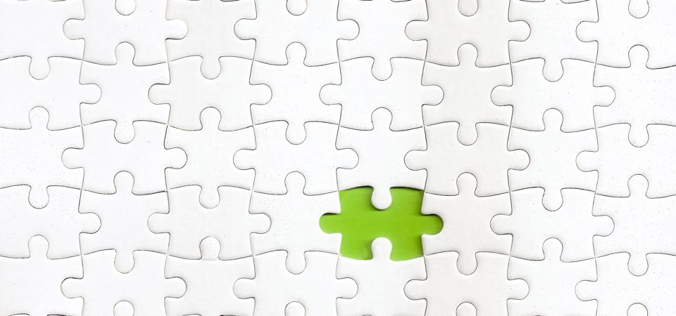 Missing piece of puzzle with a green color as background