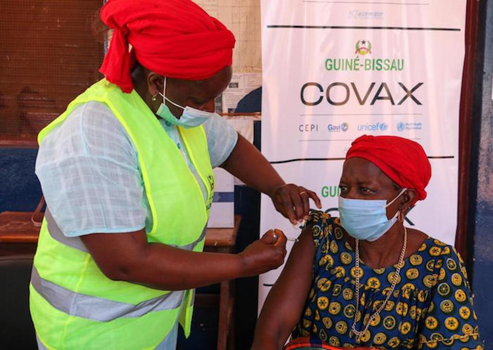 A health care worker administers a dose of COVID-19 vaccine supplied by the COVAX Facility in Guinea-Bissau on May 25, 2021. Guinea-Bissau is one of the world's poorest and most fragile countries.