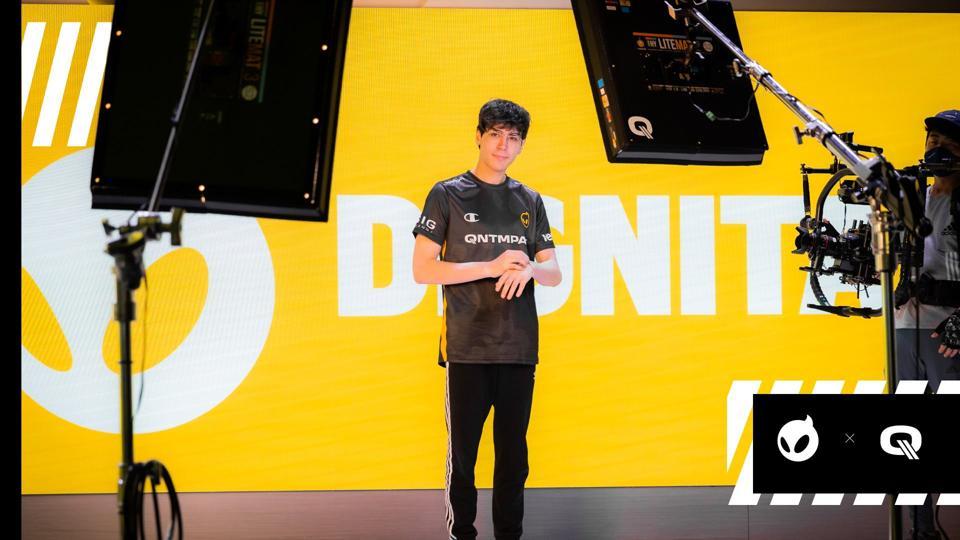 A Dignitas player poses for the cameras.