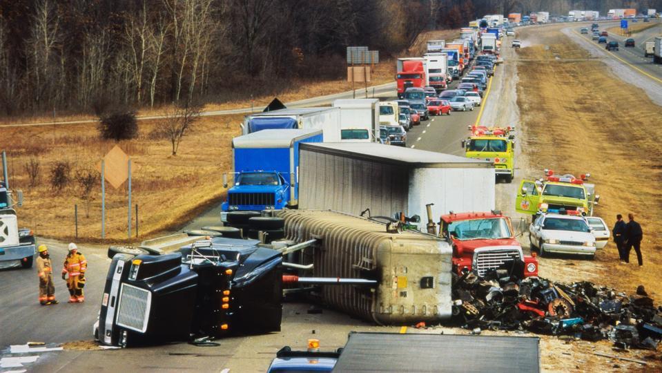 Truck overturned on highway, traffic jam behind