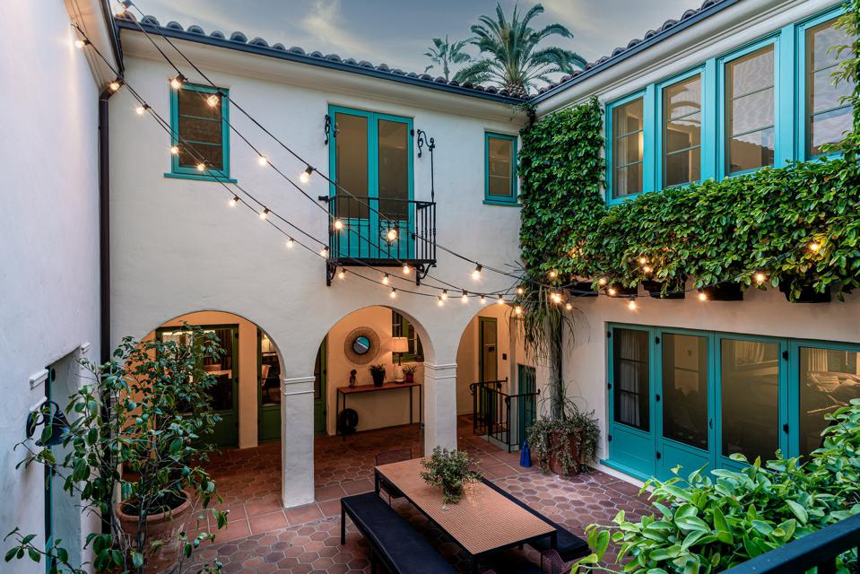 Courtyard with arched doors and strung lights