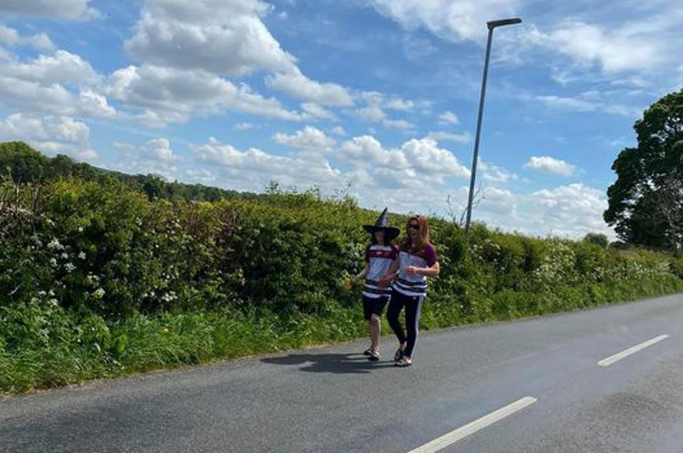 Billy and Charlotte Caldwell walking a stretch of rural road on their 1,000 mile journey through the UK